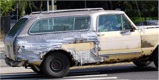 An old, banged-up car